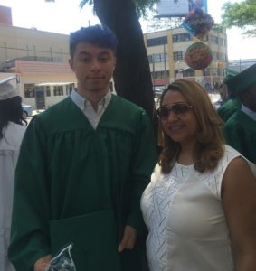 Sean with Ms. Brenda at his high school graduation
