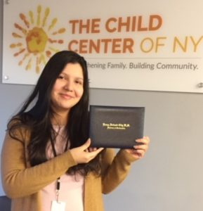 Jessica, a Child Center of NY client, with her high school diploma from Young Adult Borough Center at Flushing High School