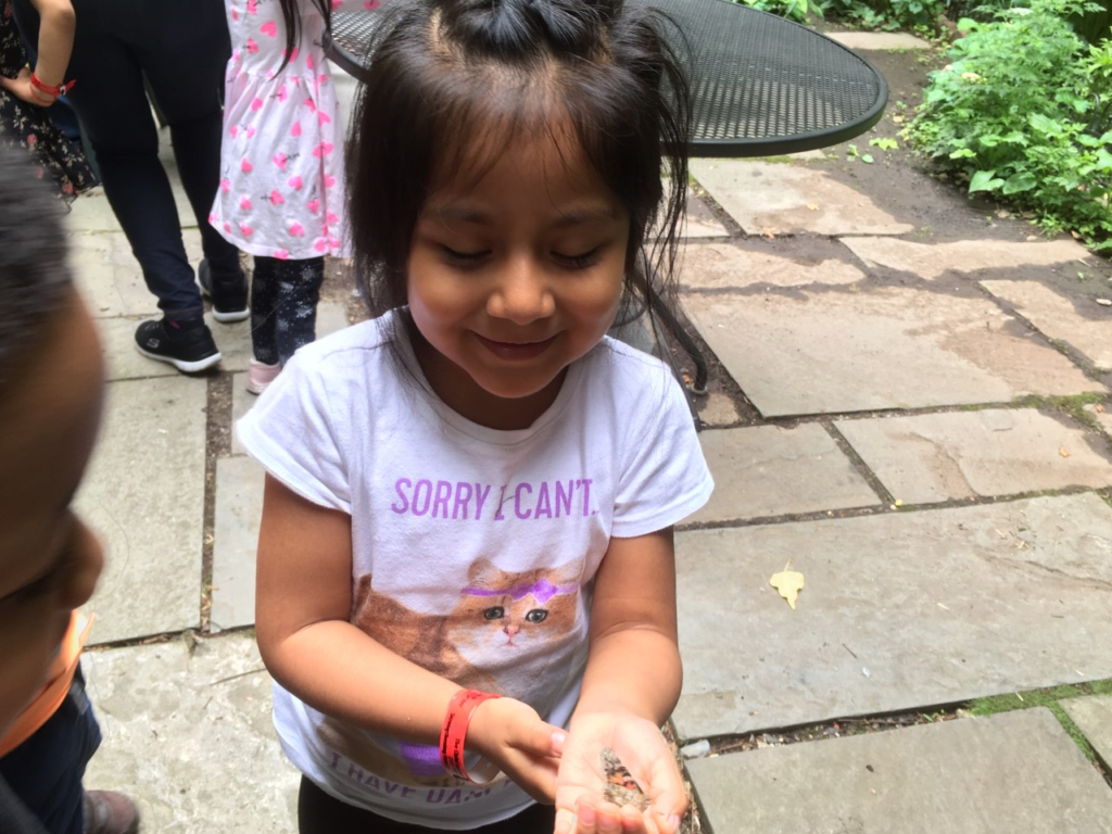 Escalara Head Start student holding a butterfly