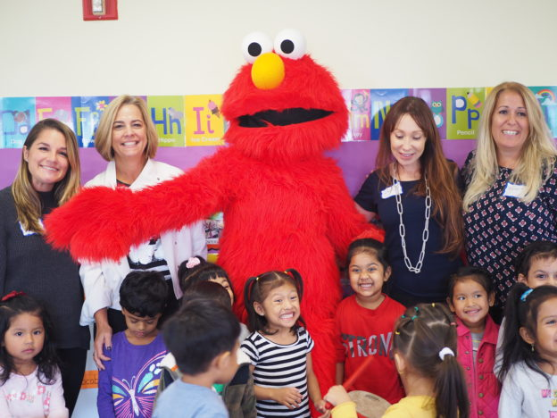 Members of IICF with Woodside Head Start/EarlyLearn students and Elmo