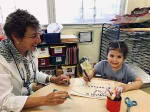 Supporter Amy Rappoport with a Woodside Head Start student