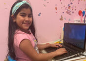 Girl at a laptop Chromebook engaged in remote learning during COVID pandemic