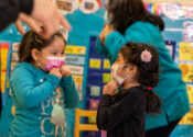 Two girls at in-person school at Head Start in Corona